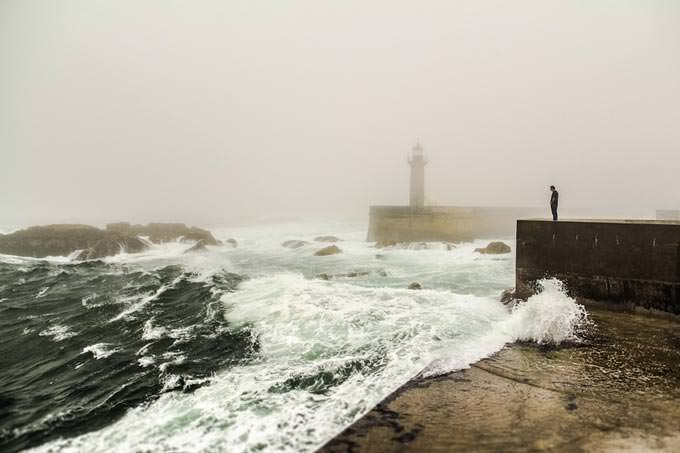 when fog reaches lighthouse by Álvaro Martino
