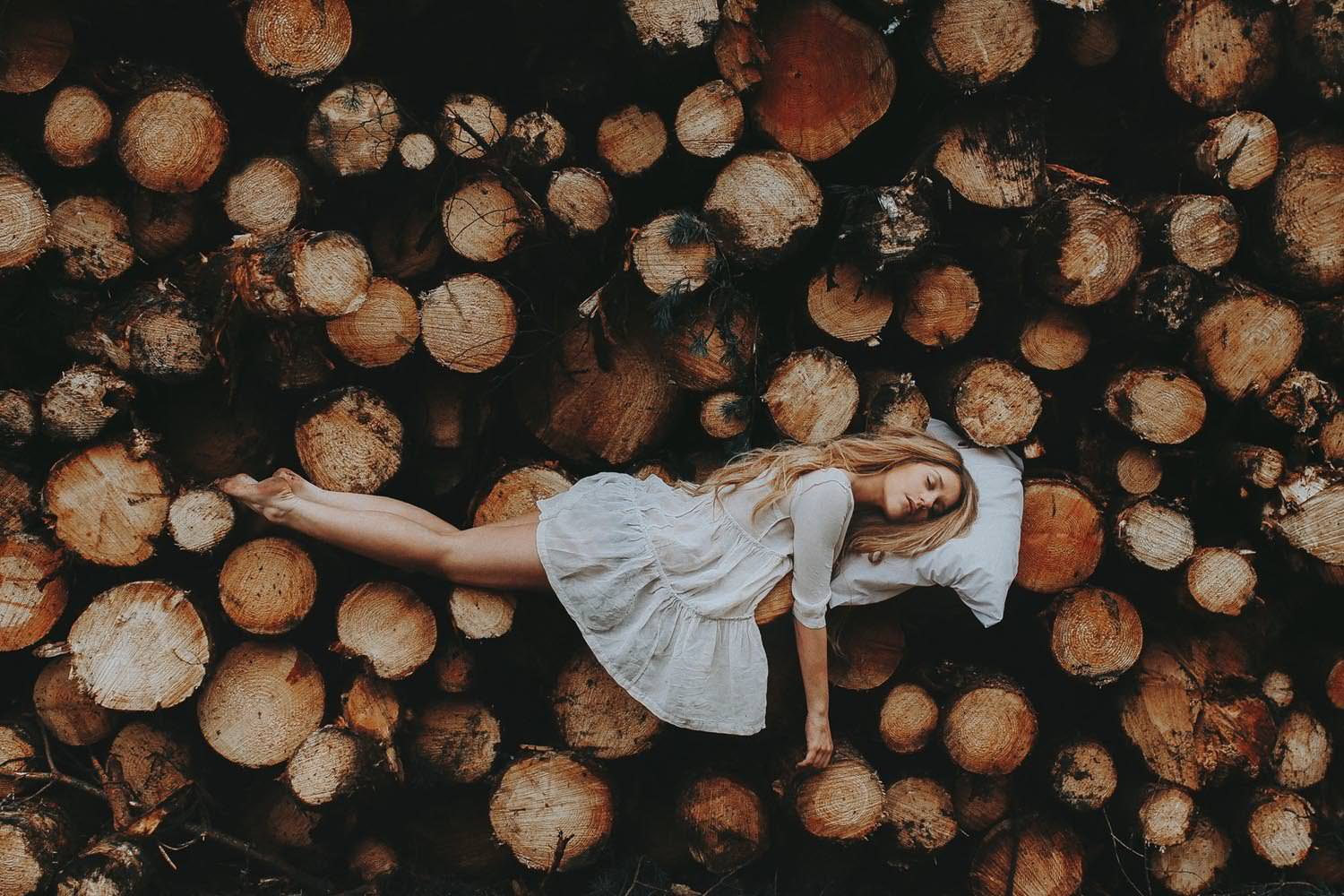 Rosie Hardy Sleeping on Logs